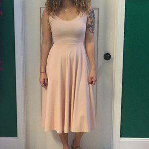 Tank top style dress. Light blush color w/pockets